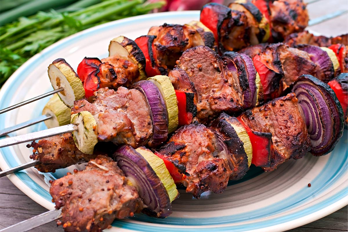 bison kabobs with onions and yellow squash