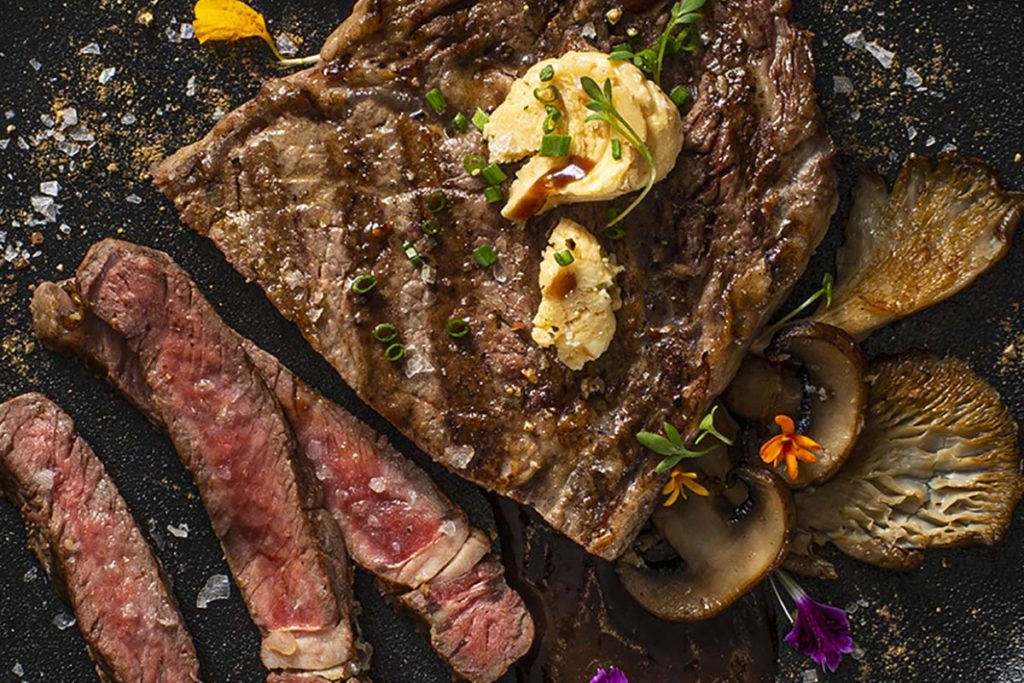 Spiced Bison Rib-Eye with Miso Butter and Red Wine Mushroom Sauce