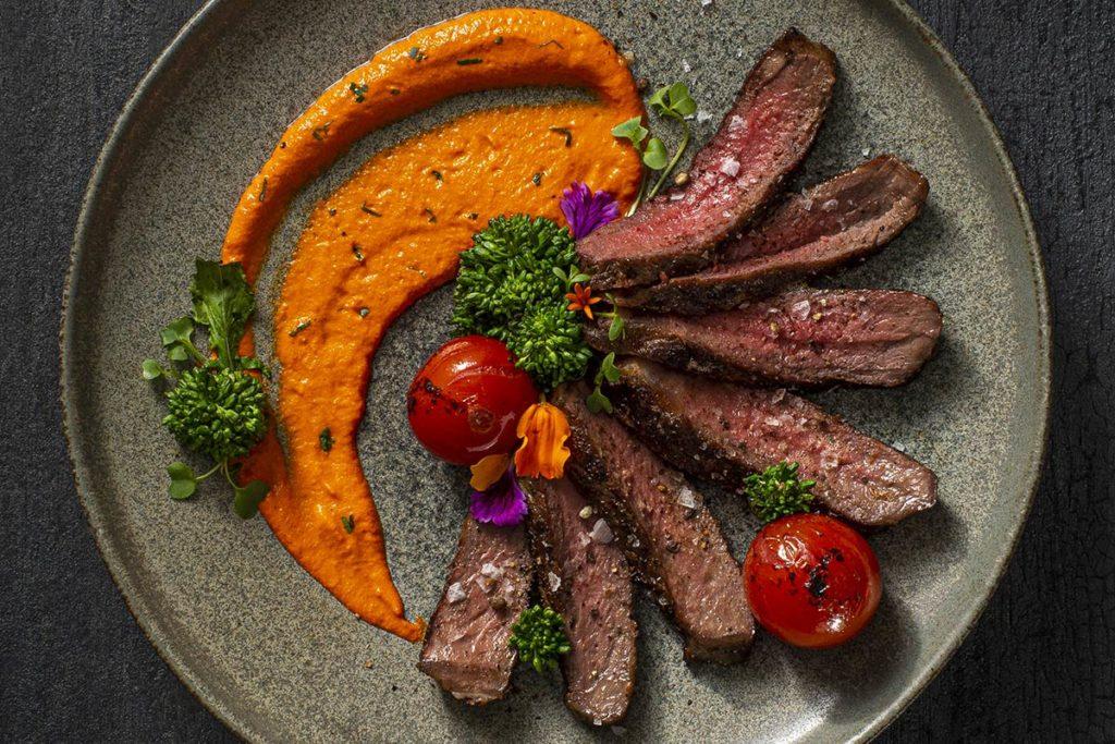 Bison Strip Loin with Romesco Sauce and Rapini